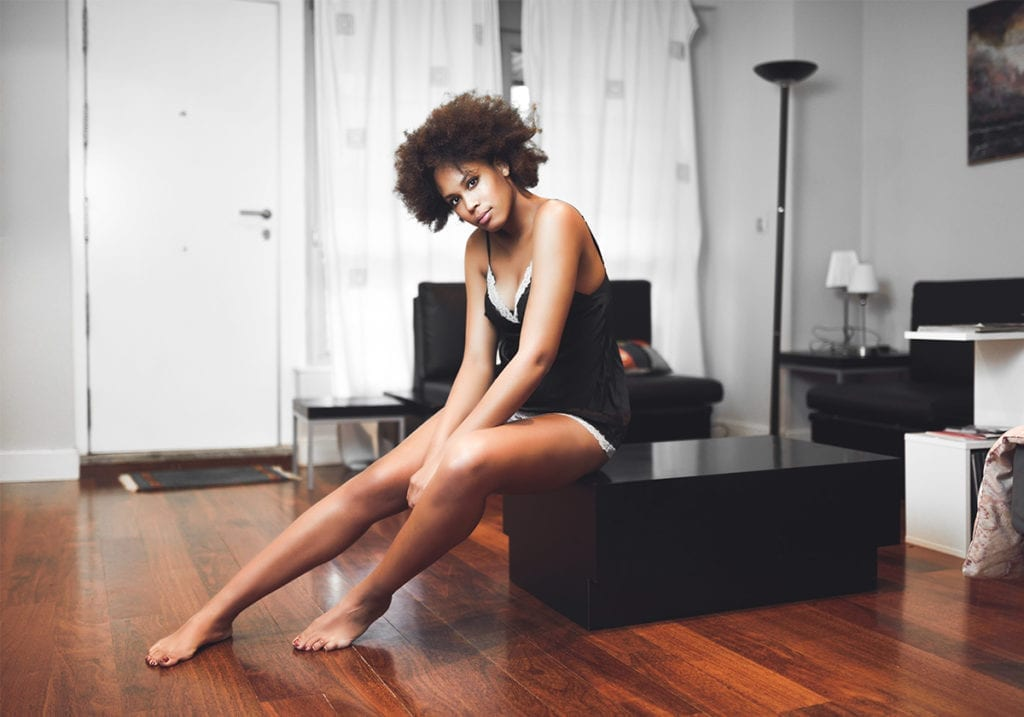 Woman sitting on box in the living Room